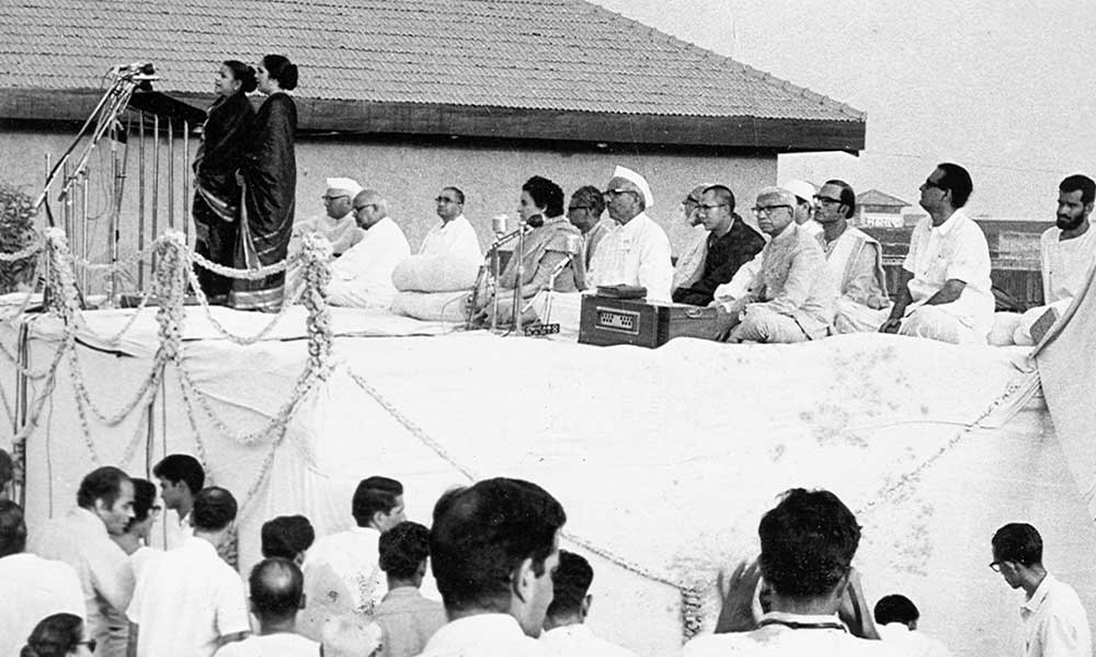 Singing the invication . Seated Shri Sadasivam, Mrs Indira Gandhi