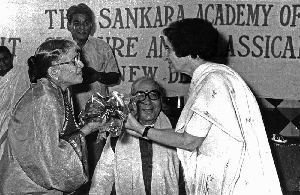 Receiving a bouquet from Smt Indira Gandhi