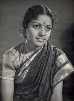 Young Subbulakshmi with thick curls and a puff sleeve blouse