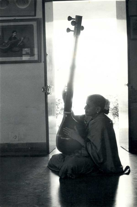 Singing with tanpura in front of her mother's picture